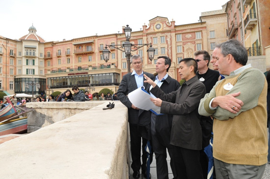 Tom Staggs visits Mediterranean Harbor during a Tokyo DisneySea park tour.  In the photo (from left to right) are Dave Vermeulen, VP &#038; Executive Managing Director, Walt Disney Attractions Japan, Tom Staggs, Daniel Jue, Director, Design and Production, Tokyo Disney Resort, Walt Disney Imagineering Japan, Jim Hunt, EVP/CFO, Walt Disney Parks &#038; Resorts, Bill Earnest, President and Managing Director, Asia, Walt Disney Parks &#038; Resorts and Craig Russell, Chief Design &#038; Project Delivery Executive, Walt Disney Imagineering.