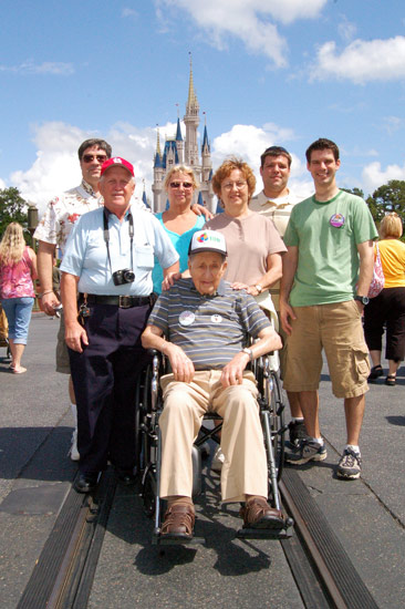 John Schmitz and family celebrating his 100th birthday at Magic Kingdom Park