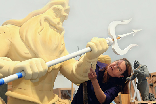 Disney Imagineer Joni Van Buren sculpts a model of King Triton, who, in his final form will be 35 feet tall and tower over guests at Walt Disney Parks and Resorts newest Resort. Disneys Art of Animation Resort will be one-of-a-kind, with themed building exteriors and room interiors that bring to life The Lion King, Cars, Finding Nemo and The Little Mermaid. Disneys Art of Animation Resort is expected to open by the end of 2012.