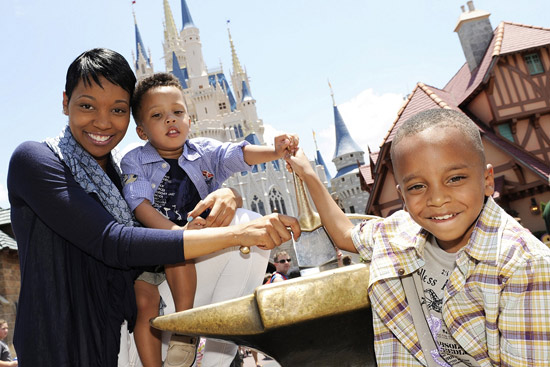 Grammy Award-winning singer Monica visits Magic Kingdom with her sons