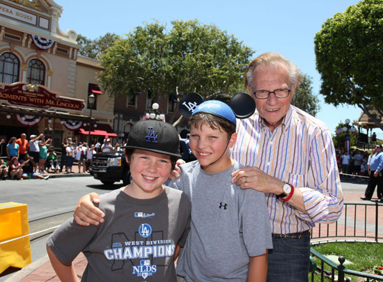 Larry King at the parade with his sons  Cannon, 10, (left) and Chance, 11