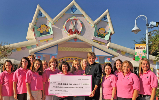 Walt Disney World Moms Panelists Present Donation to Give Kids The World Village