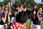 Miss Alabama 2010 Ashley Davis (left), of Dothan, Ala., gives Minnie Mouse a kiss at the Magic Kingdom.