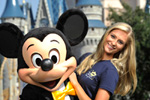 Miss Florida 2010 Jaclyn Raulerson, of Plant City, Fla., meets Mickey Mouse at the Magic Kingdom.