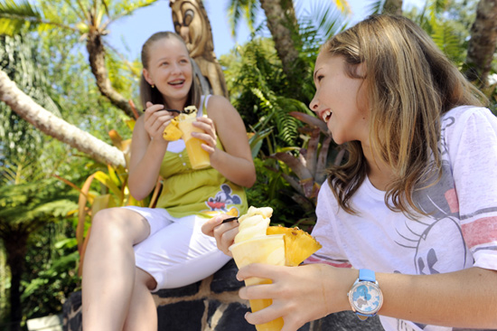 Kids enjoying dole whip to cool off