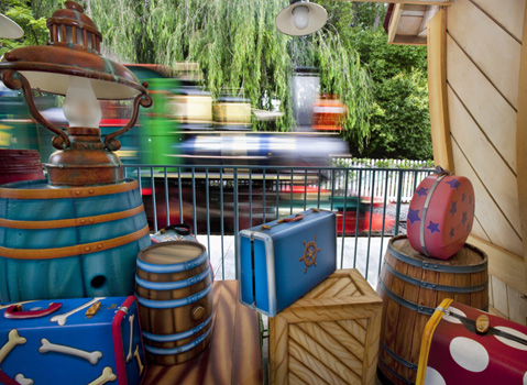 Toon-Looking Luggage at the Toontown Depot as a Train Speeds Past, By: Paul Hiffmeyer