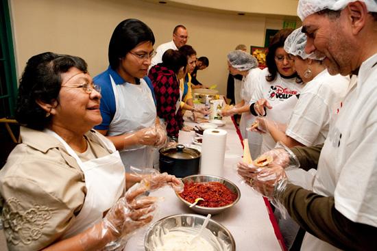 Disney VoluntEARS Helping Latino Health Access (LHA) at their annual Tamalada