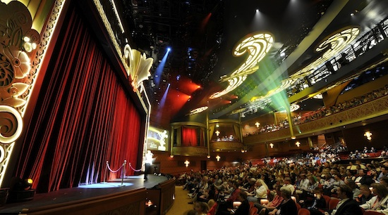 "On Friday, Cruise Director Rachel Quinn introduces ""The Golden Mickeys: A Timeless Tribute,"" one of three stage shows presented in the Walt Disney Theatre"