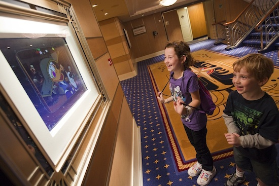 Children pause to watch framed artwork come to life – a special Disney Dream feature called Enchanted Art