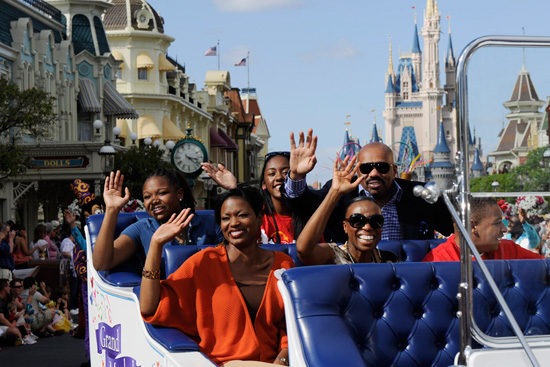 (L-R) Mikki Taylor, Essence Magazine's Editor-at-Large, high school student Princeton Parker of Los Angeles, Calif. and actor/comedian Steve Harvey serve as the grand marshals in the Magic Kingdom parade