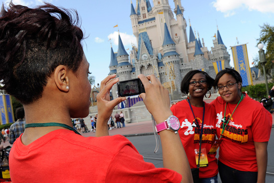High school student Dashana Collins of Irving, N.J. takes a photo March 3, 2011 of students Alexis Sheppard of Orlando, Fla. and Nautica Mitchell of Alpharetta, Ga. with her Sony Bloggie Camera at the Magic Kingdom