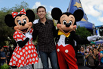 (MAY 30, 2011): Newly crowned 'American Idol' Scotty McCreery poses May 30, 2011, with Mickey and Minnie Mouse in front of 'The American Idol Experience' attraction at Disney's Hollywood Studios in Lake Buena Vista, Fla. McCreery was honored in a parade at the Disney theme park and performed his new song, 'I Love You This Big.' On Wednesday, the 17-year-old singer was crowned the new 'American Idol' on the season finale which was viewed by an estimated 29.3 million people. (Gene Duncan, photographer)