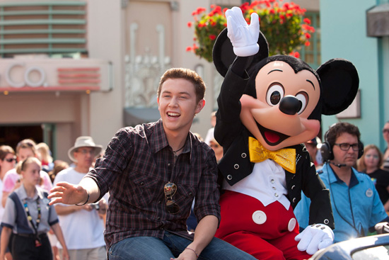 (MAY 30, 2011): Newly crowned 'American Idol' Scotty McCreery takes a celebratory ride May 30, 2011, with Mickey Mouse through Disney's Hollywood Studios in Lake Buena Vista, Fla. Scotty was honored in a parade at the Disney theme park and performed his new single 'I Love You This Big.' On Wednesday, the 17-year-old singer was crowned the new 'American Idol' on the season finale which was viewed by an estimated 29.3 million people. (Matt Stroshane, photographer)