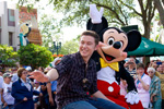 (MAY 30, 2011): Newly crowned 'American Idol' Scotty McCreery takes a celebratory ride May 30, 2011, with Mickey Mouse through Disney's Hollywood Studios in Lake Buena Vista, Fla. McCreery was honored in a parade at the Disney theme park and performed his new single 'I Love You This Big.' On Wednesday, the 17-year-old singer was crowned the new 'American Idol' on the season finale which was viewed by an estimated 29.3 million people. (Matt Stroshane, photographer)