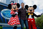 (MAY 30, 2011): Newly crowned 'American Idol' Scotty McCreery poses May 30, 2011, with Mickey and Minnie Mouse in front of 'The American Idol Experience' attraction at Disney's Hollywood Studios in Lake Buena Vista, Fla. McCreery was honored in a parade at the Disney theme park and performed his new song, 'I Love You This Big.' On Wednesday, the 17-year-old singer was crowned the new 'American Idol' on the season finale which was viewed by an estimated 29.3 million people. (Matt Stroshane, photographer)