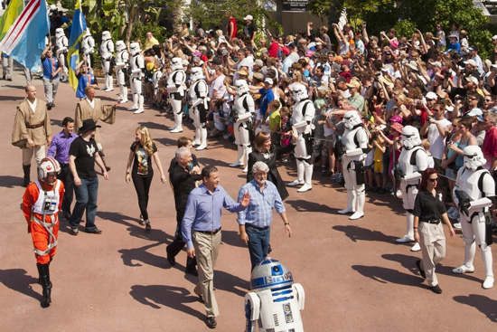 Walt Disney Co. president and CEO Bob Iger (left) waves as he walks with 'Star Wars' creator George Lucas through Disney's Hollywood Studios theme park in Lake Buena Vista, Fla. May 20, 2011 during grand opening ceremonies for 'Star Tours -- The Adventures Continue,' a new 3-D attraction based on the 'Star Wars' films. The attraction, which features more than 50 possible random ride experiences, opened May 20, 2011 at Walt Disney World in Florida and will open June 3, 2011 at Disneyland Resort in California. (Matt Stroshane, photographer)