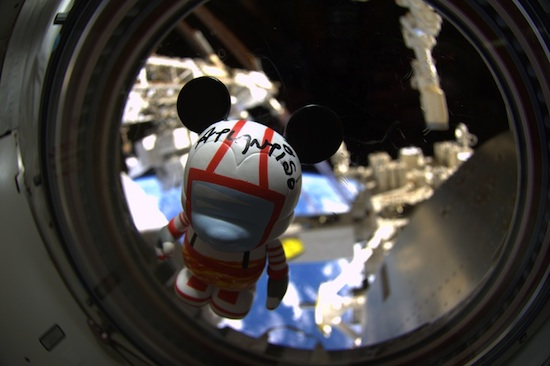 The customized Mission:SPACE-inspired Vinylmation floats inside Space Shuttle Atlantis