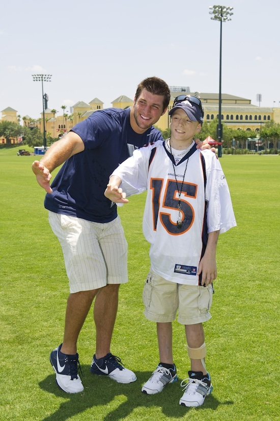 Tim Tebow and Adam Hubbs, a 16-Year-Old from Illinois at Walt Disney World Resort