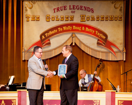 Disneyland Resort President George Kalogridis Presents Donation to Ralph Opacic, Executive Direct of the Orange County High School of the Arts