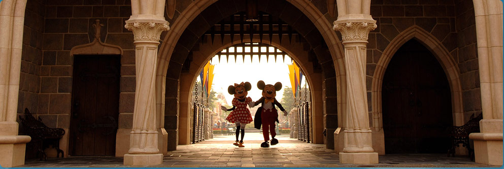 Mickey Mouse and Minnie Mouse Walk Under the Arch of Sleeping Beauty Castle at Disneyland Park