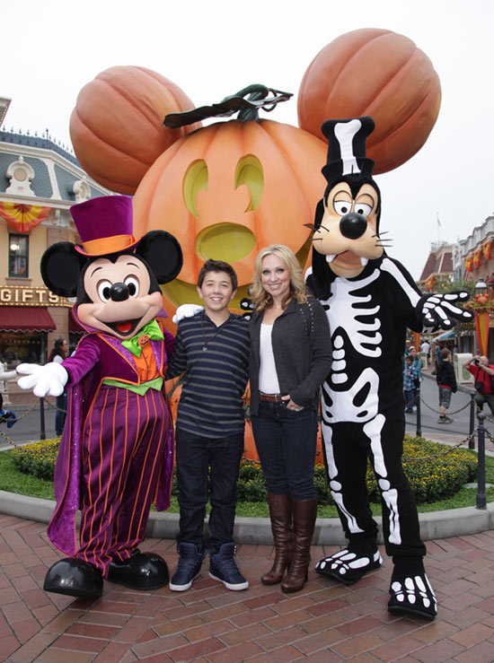 Leigh-Allyn Baker and Bradley Steven Perry from the Disney Channel Hit Series 'Good Luck Charlie' with Mickey Mouse and Goofy at Disneyland Resort