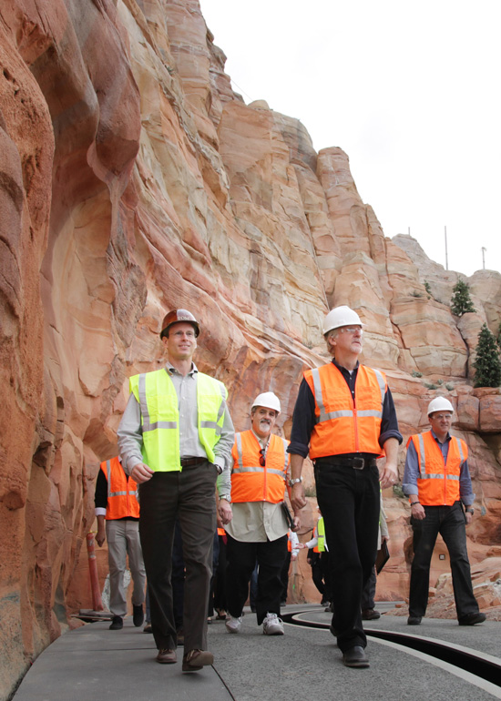 From Left: Tom Staggs, Jon Landau and James Cameron Tour Cars Land