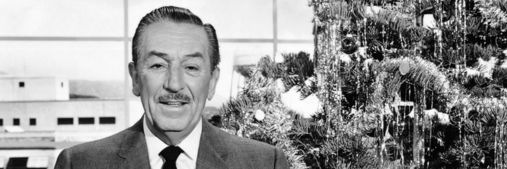 Walt Disney Stands in Front of a Christmas Tree in his Studio Office