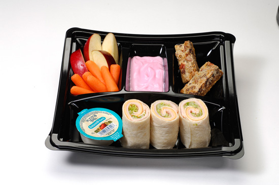 Kid's meal with turkey and American cheese wrap and strawberry yogurt, apples and carrots with ranch dip and seven-layer cookie bar, available at 'A Taste of Hollywood To Go – A Fantasmic! Dining Experience' at Disney's Hollywood Studios