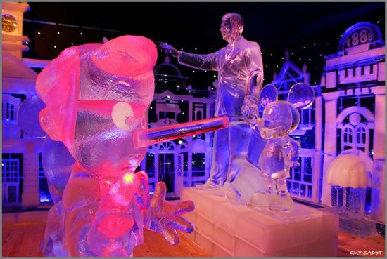 Pinocchio and Walt Disney & Mickey Mouse Partners Statue Ice Sculptures, Featured in the Interpretation of Disneyland Paris Enchanted Christmas for the 10th International Snow & Ice Sculpture Festival in Bruges, Belgium