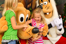 Pluto and Goofy Spreading Holiday Cheer at Walt Disney World Resort