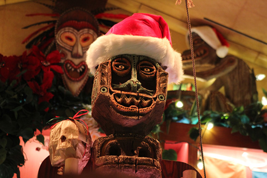 Tiki Figure Decorated for the Holidays at Trader Sam's  Enchanted Tiki Bar at the Disneyland Hotel