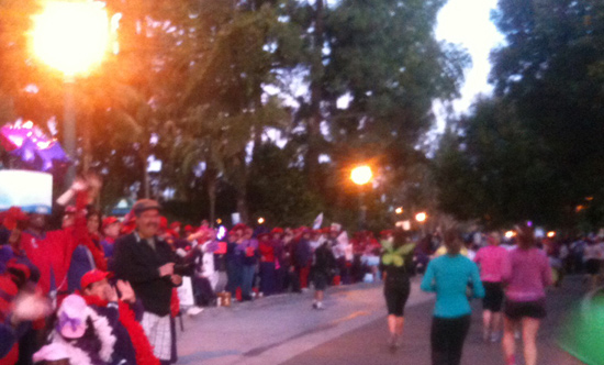 Women of the Red Hat Society Cheering on Participants in the Tinker Bell Half Marathon at the Disneyland Resort