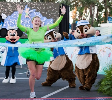 Kellie Nickerson (1:27:52), from Albuquerque, N.M., crosses the finish line to win the 2012 Tinker Bell Half Marathon at Disneyland Resort in Anaheim, Calif., on Jan. 29, 2012.