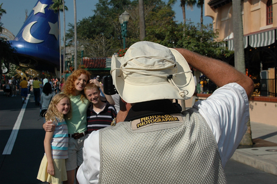 Park Goers Pose for Disney PhotoPass Photographers at Walt Disney World Resort