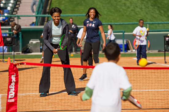 First Lady Michelle Obama participates in a fitness activity with local children at the Magic of Healthy Living event at Walt Disney World Resort. The event celebrated the First Lady's Let's Move! Initiative and recognized Disney's efforts to promote healthier lifestyles among kids and families.