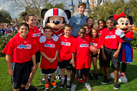Super Bowl MVP from the New York Giants Eli Manning with Mickey Mouse, Minnie Mouse and Play 60 Members at Walt Disney World Resort