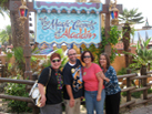 Nate and friends in front of the Magic Carpets of Aladdin attraction