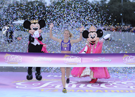 (FEB. 26, 2012): Rachel Booth, 31, of Mandeville, La., crosses the finish line to capture the 2012 Disney's Princess Half Marathon title Feb. 26, 2012 at Walt Disney World Resort in Lake Buena Vista, Fla. Booth, with an official time of 1:18:11, bested a field of 19,000 registered runners for the 4th annual 13.1-mile event. A record 27,000 athletes took part in a variety of Disney's Princess Half Marathon Weekend events, including a 5K race and a Health and Fitness Expo at ESPN Wide World of Sports Complex. Disney's Princess Half Marathon is part of the 'runDisney' series of endurance events that take place throughout the year at both Disneyland Resort in California and Walt Disney World Resort in Florida. (Preston Mack, photographer)