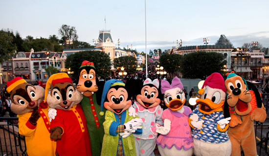 Mickey Mouse and his Friends in their Pajamas in Front of the Main Street Train Station at Disneyland Park
