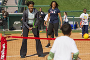 First Lady Michelle Obama participates in a fitness activity with local children at the Magic of Healthy Living event at ESPN Wide World of Sports Complex. The event celebrated the First Lady's 'Let's Move!' initiative and recognized Disney's efforts to promote healthier lifestyles among kids and families.