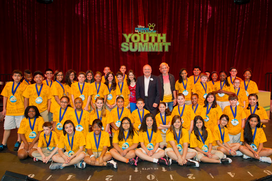Winners of the Disney Friends for Change In-school Program Disney Planet Challenge, with Jay Rasulo, Senior Executive Vice President and CFO of The Walt Disney Company, and Disney Channel Stars Laura Marano and Ross Lynch