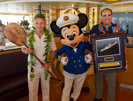 Captain Fabian, Captain Mickey Mouse, and Elliot Mills, Vice President & General Manager of Aulani