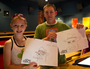 Jason Kitterman and Daughter Gracie Show Off Their Agent P Sketches.