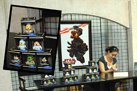 Disney Parks Vinylmation Artist Maria Clapsis Signs One of Her 'Star Wars' Creations (As Seen in the Inset) in Darth's Mall