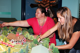 Imagineers Jackie Hererra and Laura Mitchell with the New Fantasyland Model At One Mans Dream