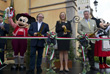 Chef Joachim Splichal, Founder of Patina Restaurant Group; Erin Youngs, Vice President of Epcot; and Nick Valenti, CEO of Patina Restaurant Group, Cut the Ribbon to Open Tutto Italia, Tutto Gusto