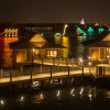 Disney Parks After Dark: View of the Electrical Water Pageant from New Bora Bora Bungalows at Walt Disney World Resort