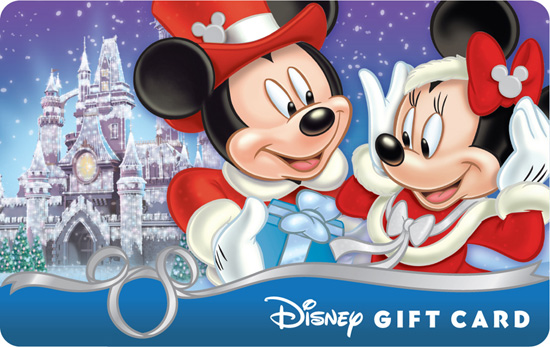 The 'Mickey &#038; Minnie  Seasons Gift' Disney Gift Card Shows Mickey Giving Minnie a Present in Front of a Frosted Castle that is Reminiscent of the Icy Spectacle Seen at Times Square a Few Weeks Ago