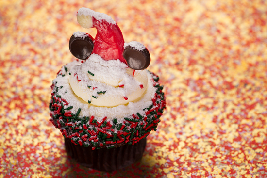 Gingerbread Cupcakes Topped with Cream Cheese Icing, Holiday Sprinkles and a Festive Minnie Mouse Hat, Available at Disney's Hollywood Studios
