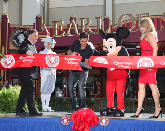 Earl of Sandwich co-founder Robert Earl, Mario Lopez and Mickey Mouse Cut the Ribbon to Celebrate the Opening of the First Earl of Sandwich Restaurant in California, Located in the Downtown District at the Disneyland Resort